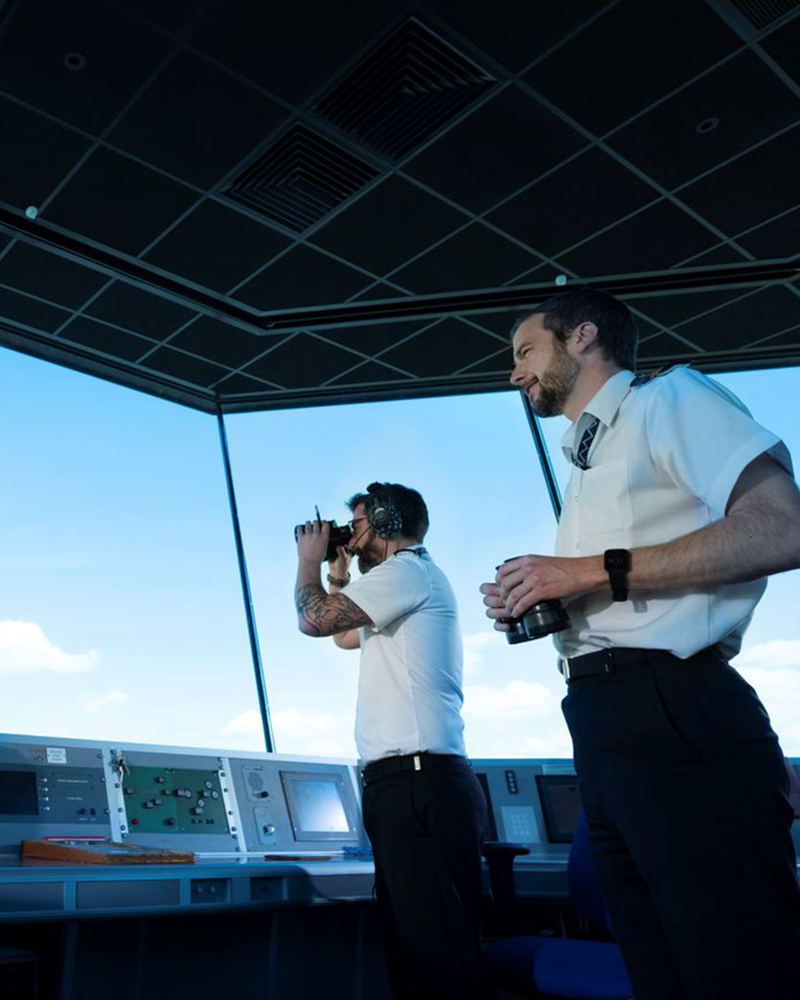 Naval officers survey the area